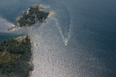 Boat tracks. Small boat tracks on surface of water in sunlit Stock Photography