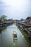 Boat and traditional canal village in Thailand Stock Photo