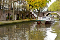 Boat on traditional dutch canal Stock Images