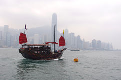 Boat in traditional style in front of Hong Kong island Royalty Free Stock Photo