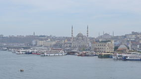 Boat traffic in Istanbul, Turkey. Istanbul, Turkey - March 23, 2014: Boat traffic near Eminonu quay  in the Golden Horn bay.  Ferry is fastest and cheapest way stock video footage