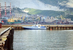 Boat traffic police moored to pier on the Royalty Free Stock Photo