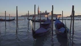 Gondolas and boat traffic in Venice with San Giorgio Maggiore stock video