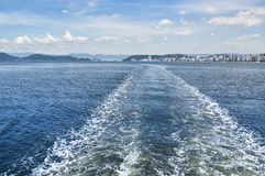 Boat trail in the sea, city of Santos Stock Image