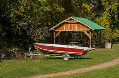 Boat & Trailer. Boat and Trailer in a picnic area with table and a shack stock photo