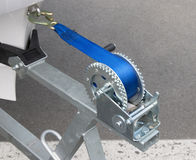 Boat trailer winch with blue rope. On shore Royalty Free Stock Photography