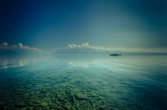 Boat on transparent Lake waters. Lake view blue stock photos