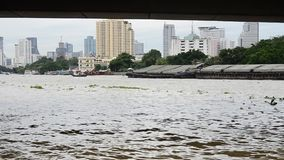 Boat Transportation on Chao Phraya River at Phra Pok Klao Bridge. The major bridges that cross the Chao Phraya are in the province of Bangkok: the Rama VI rail stock footage