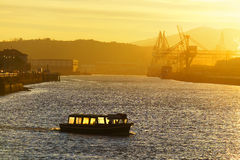 Boat transporting people at sunrise Stock Photos
