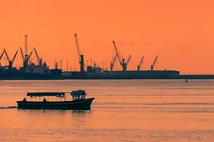 Boat transporting people at sunset. Between Getxo and Portugalete stock photo