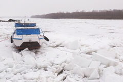 Boat trapped in the frozen Danube river Royalty Free Stock Images