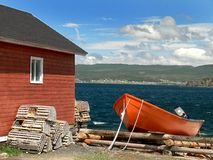 Boat and Traps 1. A picture of a boat with some lobster traps next to it shot in Canada, Newfoundland Royalty Free Stock Images