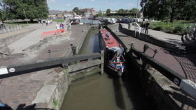 Boat travelers going through the canal lock stock footage