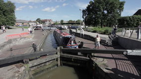 Boat travelers going through the canal lock stock video