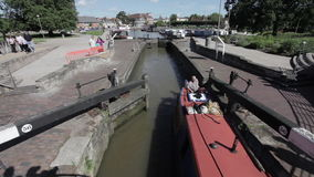 Boat travelers going through the canal lock stock video footage