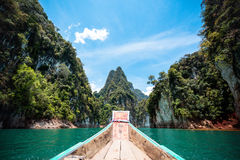 Boat traveling through great canyon or islands in Thailand, water splash, focus at the mountain Stock Photo