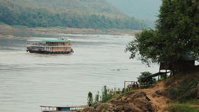 Boat traveling up the Mekong river. Tourist boat traveling up the Mekong river, Laos stock video