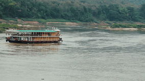 Boat traveling up the Mekong river. Tourist boat traveling up the Mekong river, Laos stock footage
