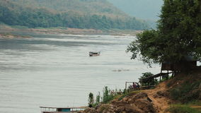 Boat traveling up the Mekong river stock footage