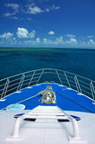 Boat travelling. To coral reef, blue sky with clouds Stock Images