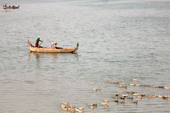 Boat travelling. A beautiful scape of Taungtaman lake you can see a nice view of U-bein bridge here Stock Image