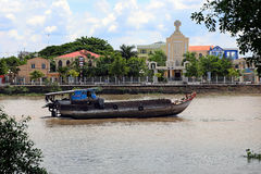 A boat travels down the Mekong river in Ben Tre, Viet Nam. A boat travels down the Mekong river in Ben Tre Royalty Free Stock Photo