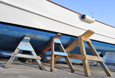 Boat on trestles in boatyard Stock Photos