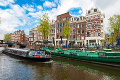 Boat trip through Amsterdam canals with houseboats along the canal, Netherlands. Stock Photo