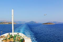 Boat trip blue sea. Passenger boat approaching Igoumenitsa port.It is a coastal city in northwestern Greece. It is the capital of the regional unit of Thesprotia Royalty Free Stock Photos