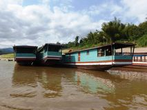 Boat trip down the River in Laos with Mekong River Boats Royalty Free Stock Image