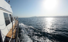 A boat trip on the high seas. Seascape boat on the high seas clear sunny day Stock Photo
