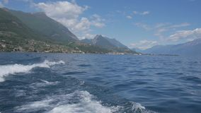 Boat trip on Lake Garda, in northern Italy. Crystal clear water, surrounded by mountains. Panorama of the gorgeous Lake Garda surrounded by mountains, Italy stock footage