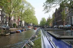 Boat trip on the picturesque canal. View of the canal from the boat. stock photos