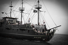 Pirate ship with tourists sailing on the open sea Stock Images