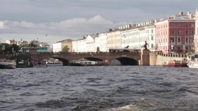 Boat trip on the rivers and Chanels of St. Petersburg. Tourists making photos on boat. Saint Petersburg in summer time. Boat trip on the rivers and Chanels of stock footage