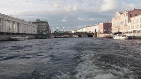 Boat trip on the rivers and Chanels of St. Petersburg. Tourists making photos on boat. Saint Petersburg in summer time. Boat trip on the rivers and Chanels of stock video footage