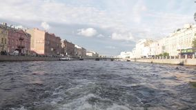 Boat trip on the rivers and Chanels of St. Petersburg. Tourists making photos on boat. Saint Petersburg in summer time. Boat trip on the rivers and Chanels of stock video