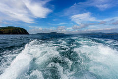 Boat trip on sunny day. Image of waves and sea Stock Images