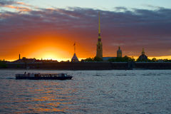 The boat trip on the sunset at the walls of the Peter and Paul fortress. Saint-Petersburg Royalty Free Stock Images