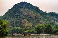 Boat trip to Perfume Pagoda, Chua Huong, North of Vietnam. Perfume Pagoda royalty free stock photo