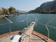 Boat trip in Turkey. View from deck of a boat on a trip around Dalyan river in Turkey. View of boats and mountains stock image