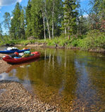 A boat trip on the wild Northern river. Royalty Free Stock Photo