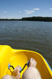 Boat trip. Yellow pedalo on the pond royalty free stock image