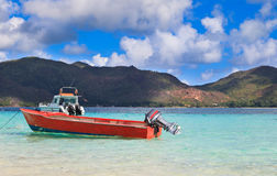 Boat on tropical beach Stock Images