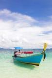 Boat at tropical beach Stock Photos