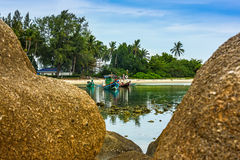 Boat on tropical beach. Fishing boat on tropical beach between rocks stock photos