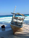 Boat on tropical beach Stock Photography