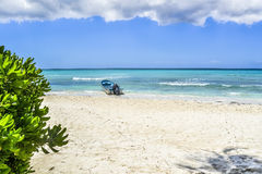 Boat on tropical beach Stock Image