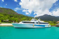 Boat at tropical blue lagoon Stock Images