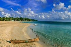 Boat on tropical caribbean beach Royalty Free Stock Photo